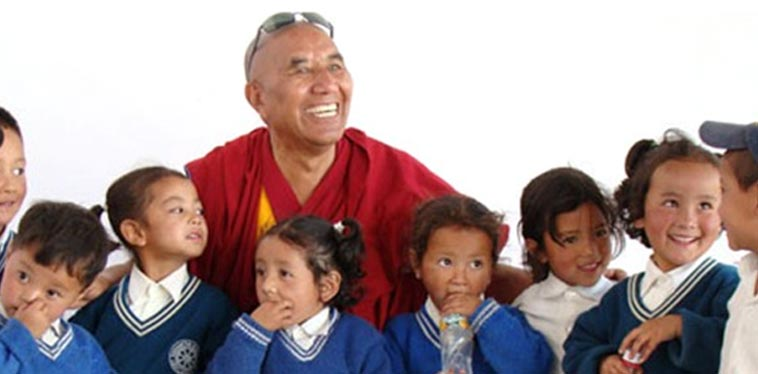 Khensur Rinpoche Lobzang Tsetan is the Founder of the Siddhartha School Project, a Himalayan charity school in Ladakh, India. Khensur is former head abbot of the Tashi Lhunpo Monastery in India by appointment of H.H. Dalai Lama. Photo of Khensur Rinpoche Lobzang Tsetan and students from Siddhartha School in Ladakh, India.